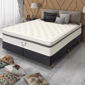 Uma cama top de linha e um sofá que parece o céu de tão macio