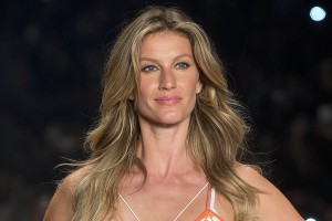 "FILE - In this April 15, 2015 file photo, Brazilian supermodel Gisele Bundchen wears a creation from the Colcci Summer collection at Sao Paulo Fashion Week in Sao Paulo, Brazil. The United Nations said that Bundchen has been named a goodwill ambassador as part of an unprecedented global campaign to fight the illegal trafficking of wildlife entitled ""Wild for Life.""   (AP Photo/Andre Penner, File)"