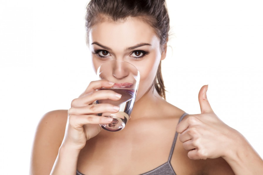 Woman-Drinking-Water-Gives-Thumbs-up